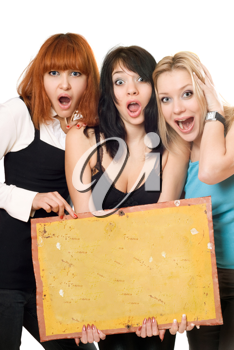 Royalty Free Photo of Three Young Women Holding a Board