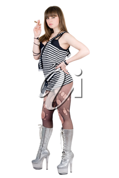 Royalty Free Photo of a Girl in a Striped Dress and High Boots Smoking