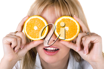 Royalty Free Photo of a Woman With Orange Slices Over Her Eyes