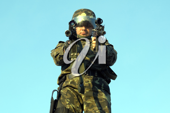Royalty Free Photo of a Soldier Holding Two Guns