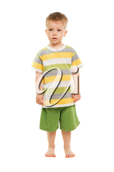 Nice blond boy posing in t-shirt and shorts. Isolated on white