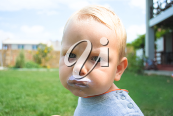 Royalty Free Photo of a Little Boy With Food on His Face