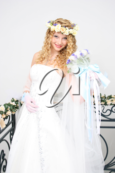 Royalty Free Photo of a Bride Holding a Bouquet