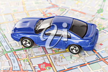Royalty Free Photo of a Toy Car on a Map