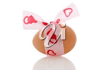 Royalty Free Photo of an Egg With a Ribbon