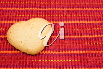 Royalty Free Photo of a Cookie on a Tablecloth