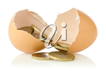Broken  eggs with coins on white background