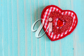 Decorative red heart on nice wooden background with copy-space