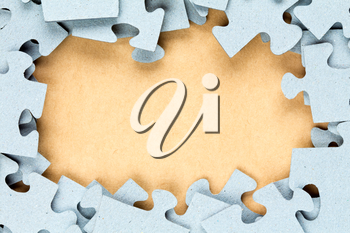 Blue jigsaw frame with paper background for copy-space