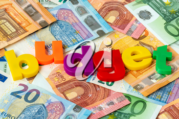 Euro currency and word BUDGET made from colored plastic letters