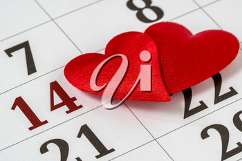 Valentine's day background, February 14 on the calendar with red hearts
