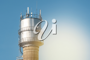 Top of Water tower with communication antennas. Old water tower with 4G communication antennas.