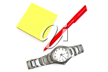 A stack of yellow office paper with a red pen and a silver watch isolated on white background