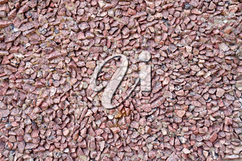 The wall, built of fine granite gravel red, reinforced cement