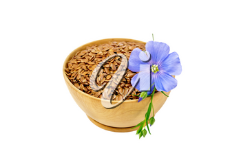 Brown flaxseeds in wooden bowl with blue flower isolated on white background