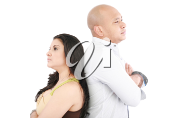 Young couple standing back to back having relationship difficulties on white background