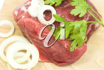 Royalty Free Photo of Meat on a Cutting Board