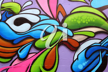 Detail of a colorful graffiti art on a wall, abstract background