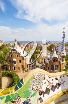 BARCELONA, SPAIN - SEPTEMBER 3: Park Guell main entrance pavilions on September 5, 2012 in Barcelona, Spain. View on Barcelona and main entrance pavilions of Park Guell from the main terrace with the
