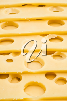 Royalty Free Photo of Slices of Cheese with Holes