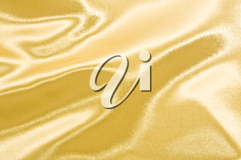 Golden satin or silk background with beautiful waves