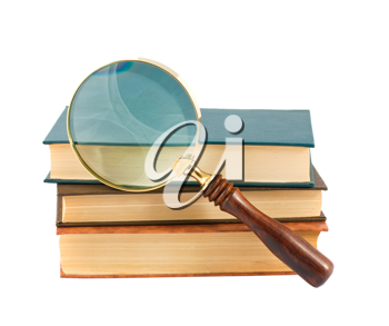 Royalty Free Photo of a Stack of Old Books with a Magnify Glass