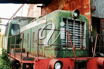 Old rusty locomotive standing on rails, closeup image