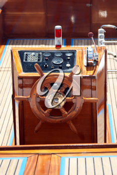 Royalty Free Photo of a Steer and Compass on a Boat