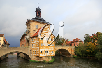 Obere bridge (brücke) and Altes Rathaus and cloudy sky in Bamberg, Germany