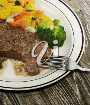 Plate Of Baked Beef With Vegetables