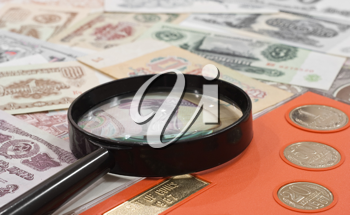 Royalty Free Photo of a Magnifying Glass on Money