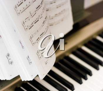 Royalty Free Photo of Music Notes on a Piano