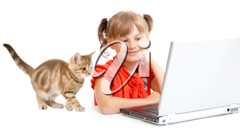 Royalty Free Photo of a Girl Using a Laptop With a Kitten