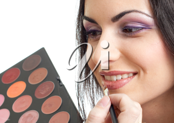 Royalty Free Photo of a Woman Getting Makeup Applied