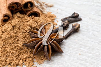 Cloves, anise and cinnamon isolated on white background