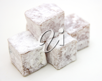 Turkish delight (lokum) confection on a white background