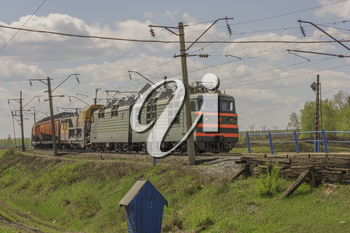 Green freight train transports cargo by rail.