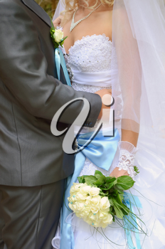 bride is a groom and wedding bouquet