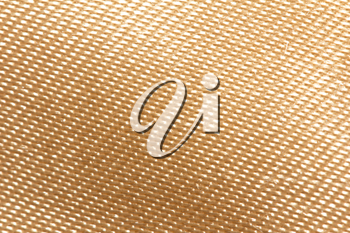 golden fabric as a background. macro