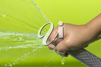 spray water from a hose child's hand