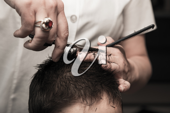 haircut at the barber scissors