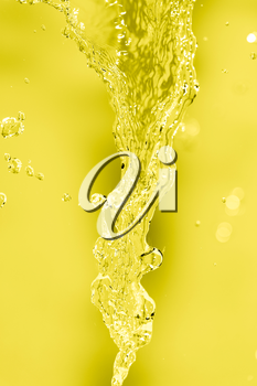 splashes of water on a yellow background