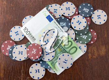Casino chips and cards, and a hundred euros on the table