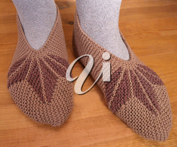 Hand knitted female slippers