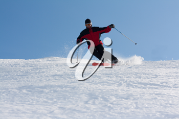 Royalty Free Photo of a Man Skiing Down a Mountain