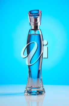 Womens perfume bottle on a blue background with a gradient light spot.