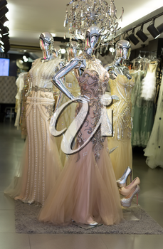 Fashionable evening dresses on mannequins silver