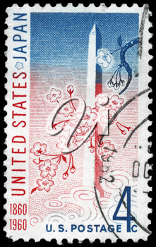 Royalty Free Photo of 1960 US Stamp Shows the Washington Monument and Cherry Blossoms, US - Japan Treaty
