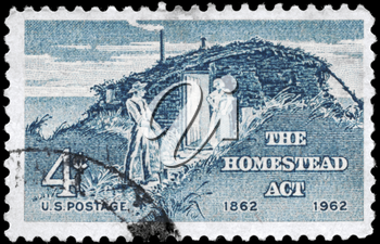 Royalty Free Photo of 1962 US Stamp Shows the Sod Hut and Settlers, Homestead Act Centenary