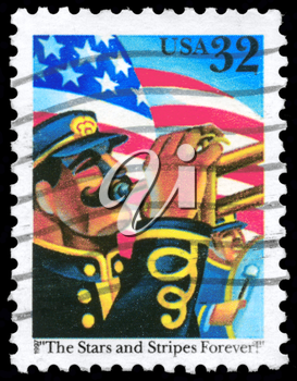 Royalty Free Photo of 1997 US Stamp Shows the US Flag and Trumpeter, Inscribed With The Stars and Stripes Forever